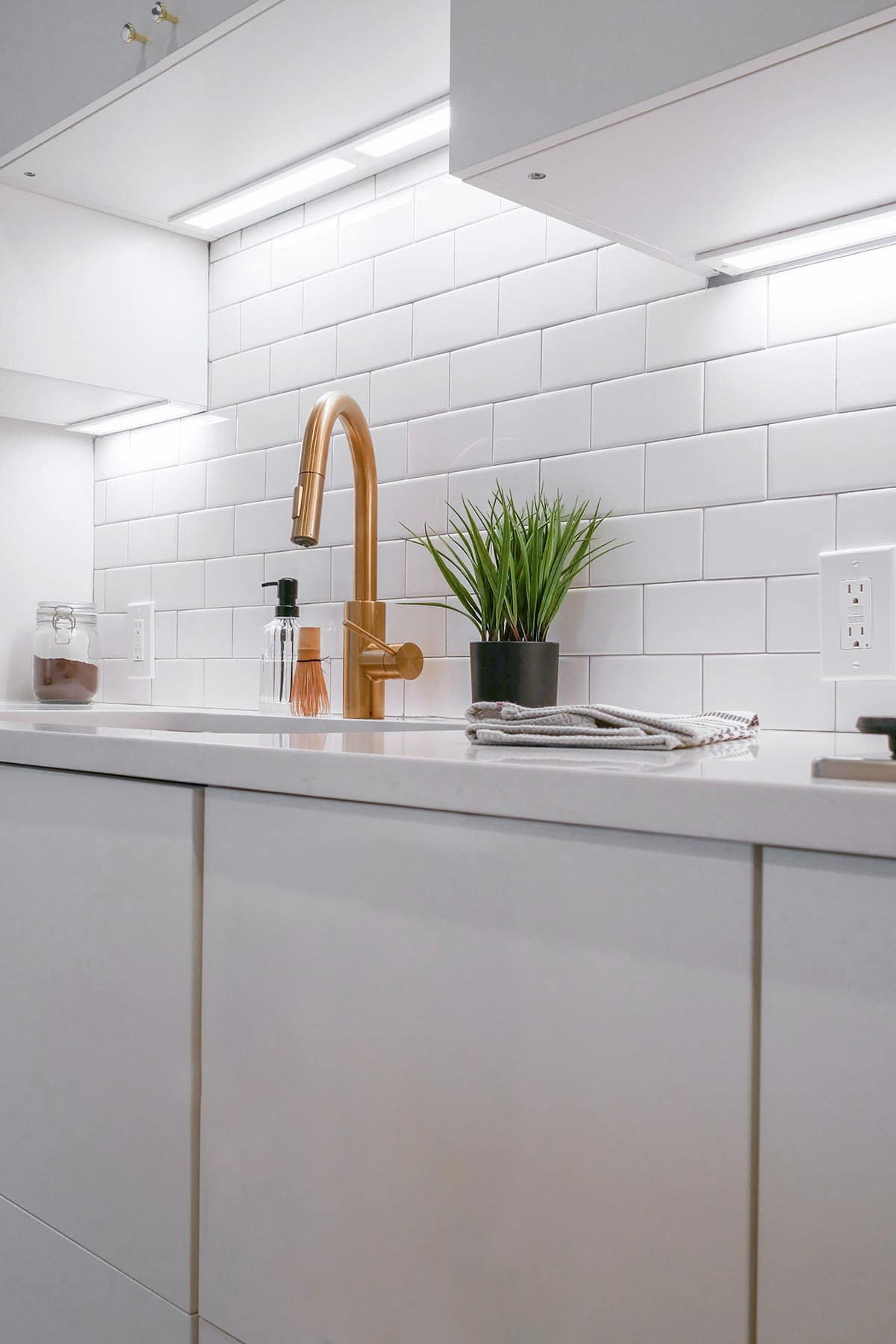 White Kitchen with Gold Faucet