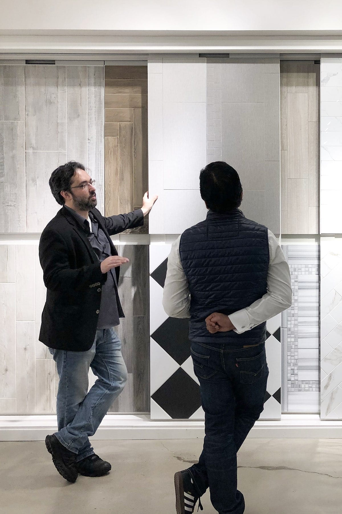 Architect Jorge Fontan and client at a showroom